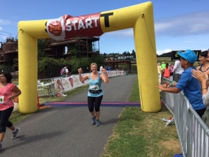 Jo finishing the See Jane Run Half Marathon